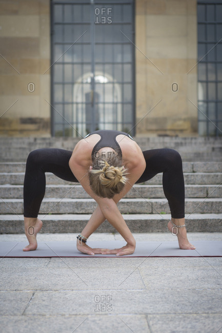 Young woman practicing yoga in the city