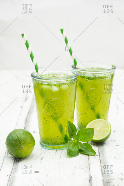 Two glasses of organic lime lemonade with basil