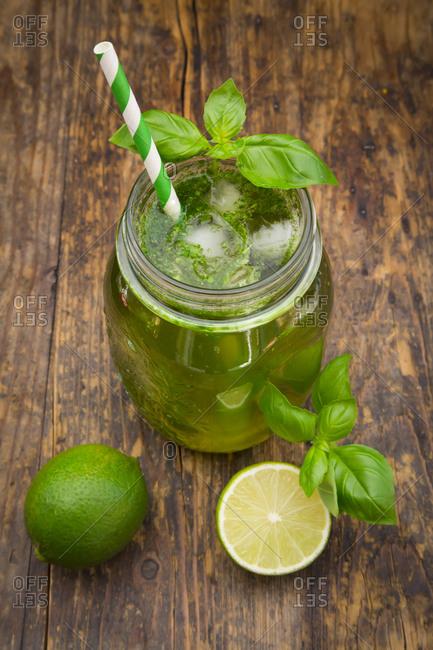 Glass of organic lime lemonade with basil