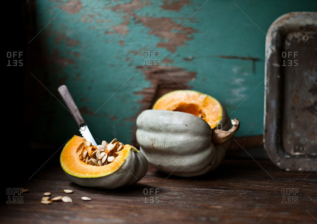 Pumpkin slice with an inserted knife in a rustic atmosphere
