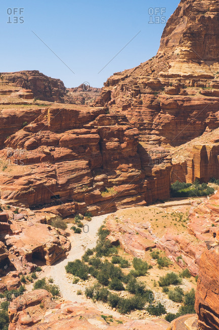 Trail through red rocks at the archaeological site of Petra