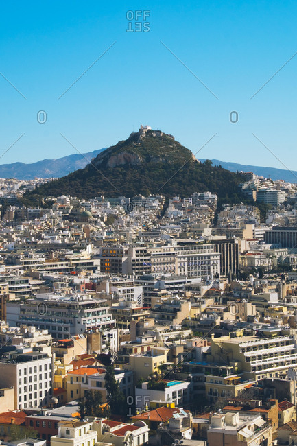 Athens, Greece - March 23, 2017: Mount Lycabettus surrounded by city buildings