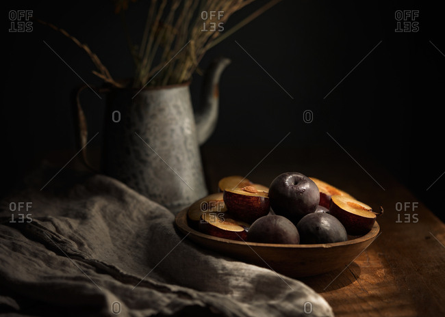 Plums in a wooden bowl