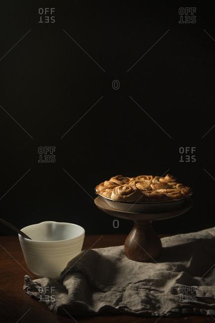Cinnamon rolls on a stand