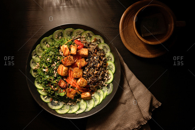 Overhead view of a wild rice tofu bowl