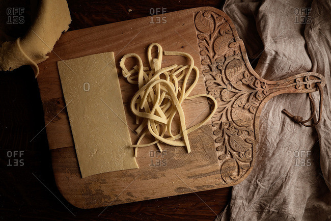 Homemade pasta noodles on a cutting board