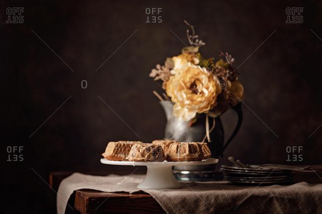 Lemon poppy seed mini Bundt cakes served on a cake stand