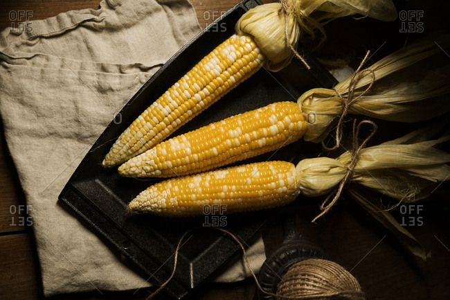 Roasted corn served on a plate