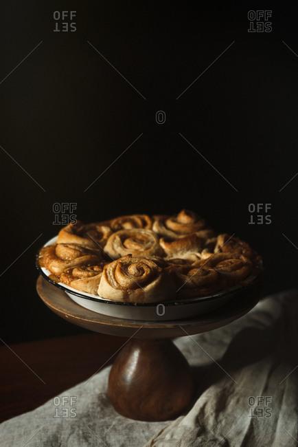 Vegan cinnamon rolls on a stand