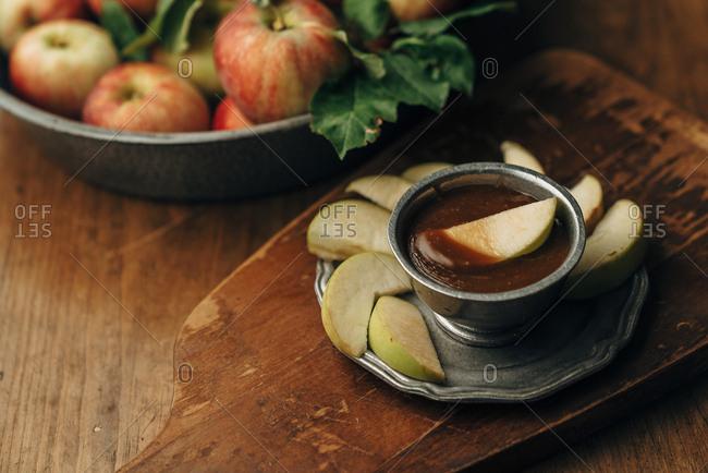 Apple slice and vegan caramel sauce