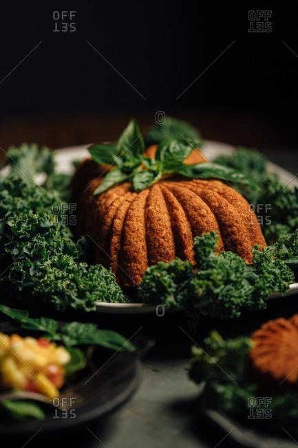 Vegan loaf on a platter of kale