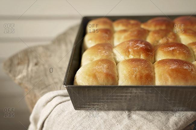 Warm homemade dinner rolls in a pan