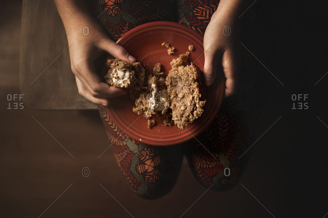 Child eating a warm muffing for breakfast