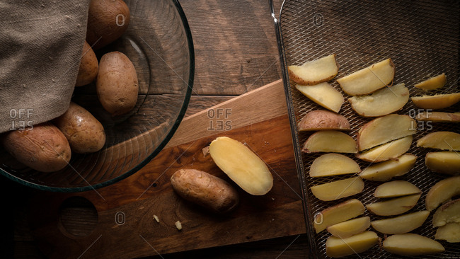Sliced potatoes being arranged in a basket