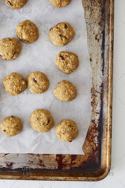 Oatmeal raisin cookies on a baking pan