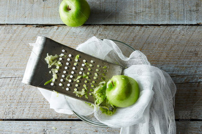 Green apple being grated