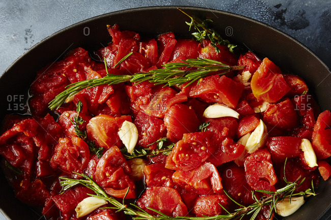 Slow roasted canned tomatoes in a frying pan
