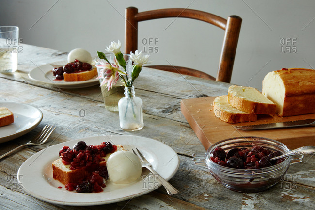 Cherries jubilee served with pound cake and ice cream