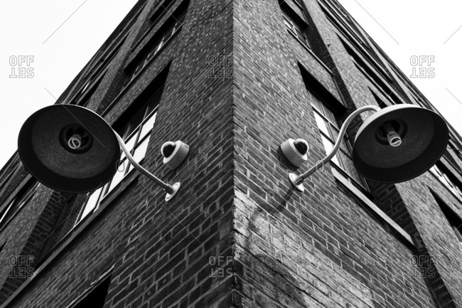April 25, 2016 - New York, NY: Architectural detail of street lights on a brick loft building