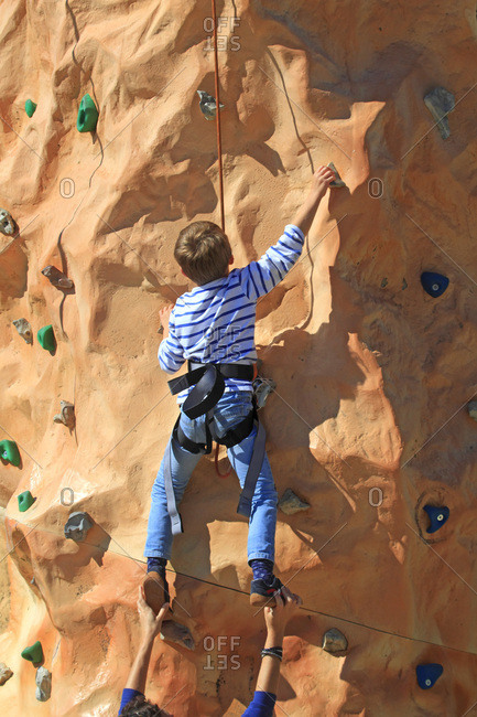 France, child on climbing wall