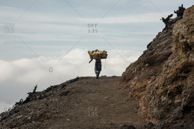 February 11, 2016: Indonesia, Java, Kawah Ijen volcano crater, sulphur miners.