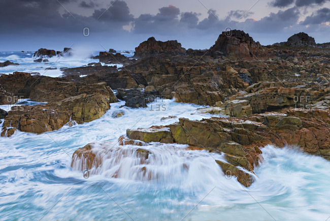 "France, Brittany, ""Pointe du Chateau en Plougrescant"" early in the morning, stormy sea"
