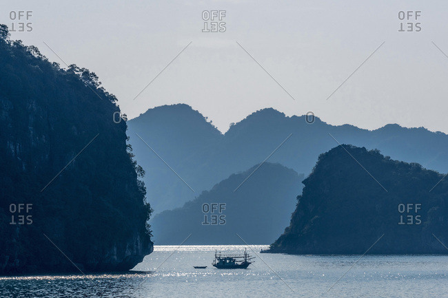 Vietnam, Ha Long Bay in the evening, fisher's small boat (UNESCO World Heritage)