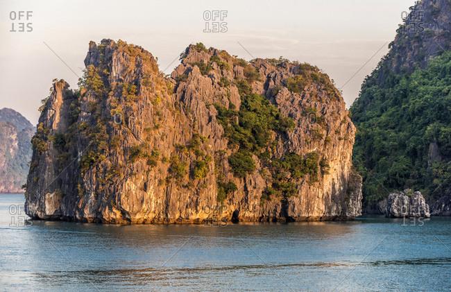 Vietnam, evening light on the Ha Long Bay, (UNESCO World Heritage)
