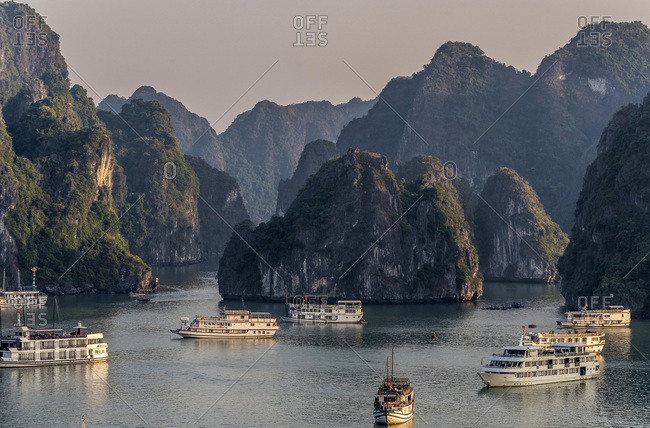 December 7, 2016: Vietnam, Ha Long Bay, cruise boat in the middle of islets (UNESCO World Heritage)