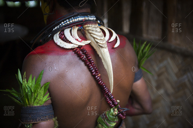 Male Huli wearing a hornbill beak around her neck, Papua New Guinea