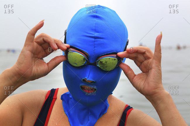 Asia, China, Shandong Province, Qingdao. Huiquan Bay, Beach Number 1. Facekini