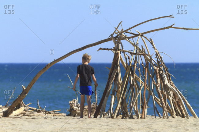Boy and hut on the beach