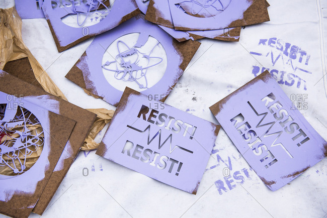 New York City, New York, USA - April 22, 2017: March for Science stencils covered in purple paint