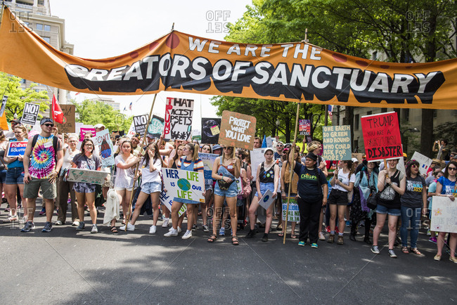 Washington D.C, USA - April 29, 2017: People holding signs and banners at The People's Climate March