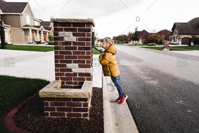 Boy checking mailbox