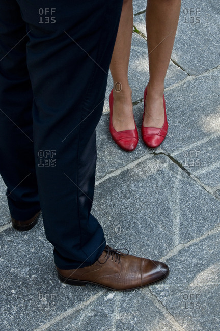 Low section of two people on the street wearing fancy shoes