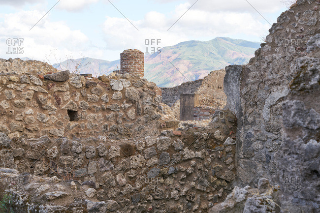 Ancient stone walls at the archaeological site of Pompeii