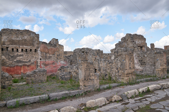 Remains of ancient buildings at the archaeological site of Pompeii