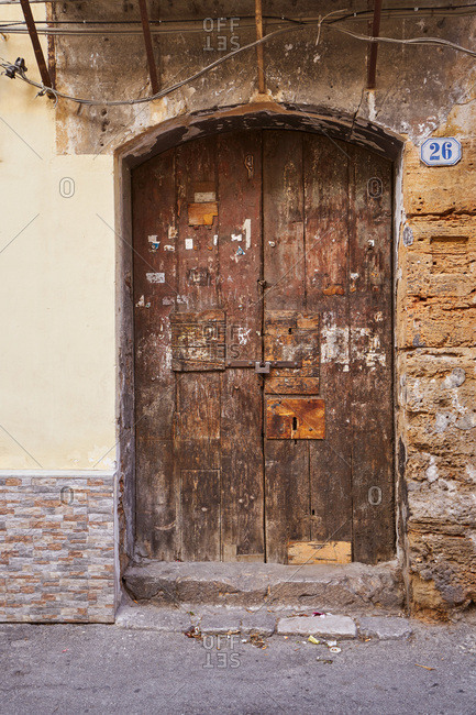 Old wooden door at entrance to building in Palermo, Sicily