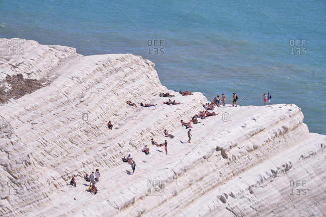 Realmonte, Sicily, Italy - September 21, 2017: People relaxing on the Turkish Steps overlooking the Mediterranean Sea