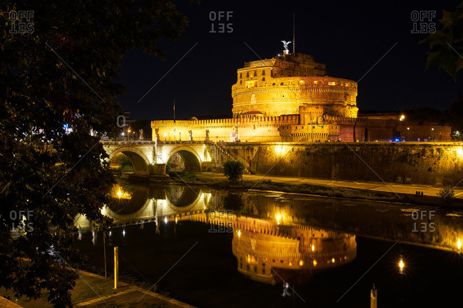 Historic castle and bridge in Rome at night