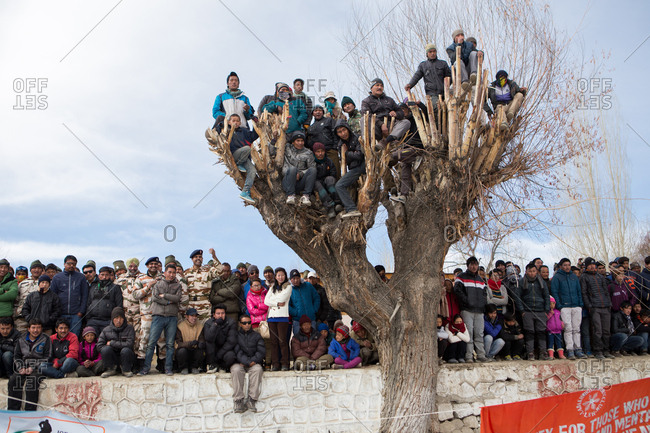 Ladakh, India - February 13, 2015: Fans watching a hockey game