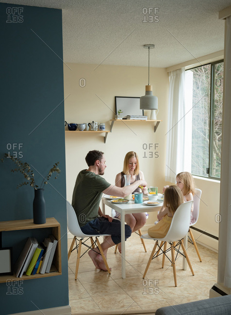 Family having breakfast in kitchen at home