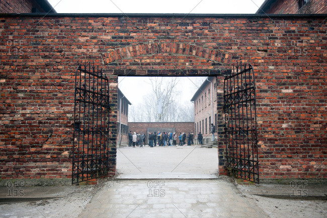 Oswiecim, Poland - December 19, 2016: Tourists at Auschwitz-Birkenau Memorial and Museum
