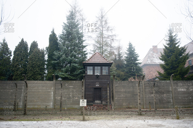 Guard post behind a barbed wire fence at Auschwitz-Birkenau