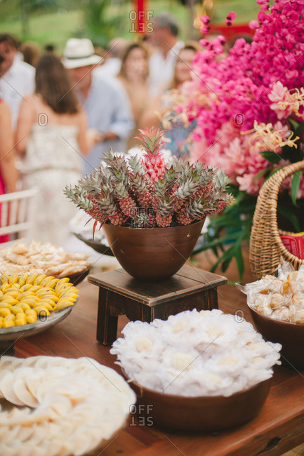 Table with desserts at tropical wedding reception