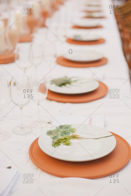 Place settings at reception for tropical wedding