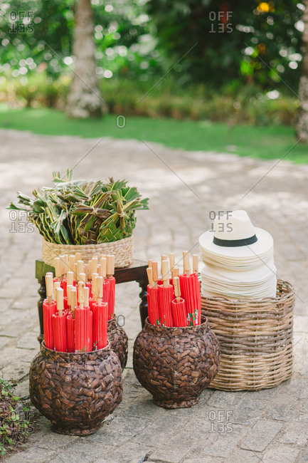 Baskets with parasols and hats at wedding reception