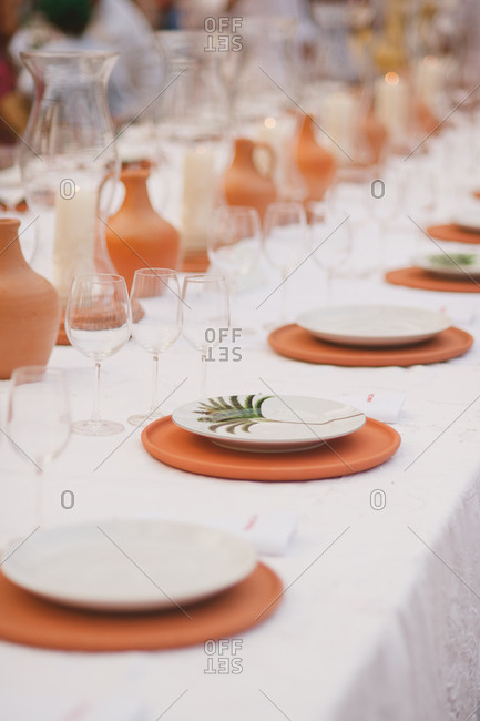 Set table and place settings for tropical wedding reception