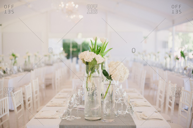 Table with white floral centerpiece at wedding reception